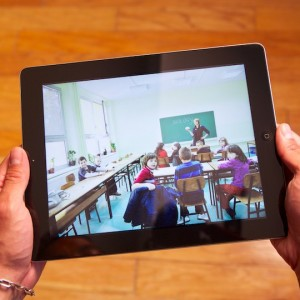 Tablet PC with traditional classroom scene